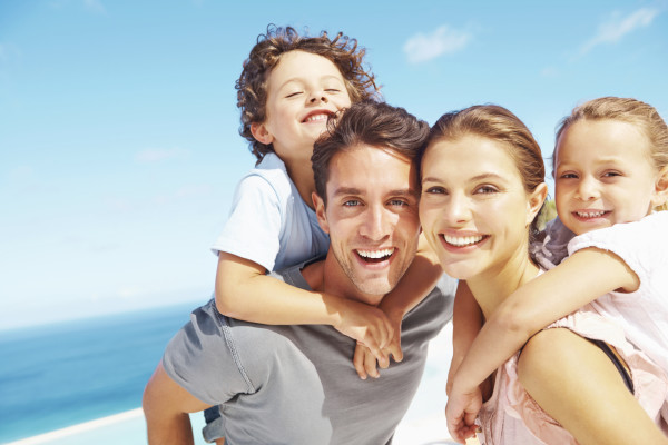 Smiling young family spending time together